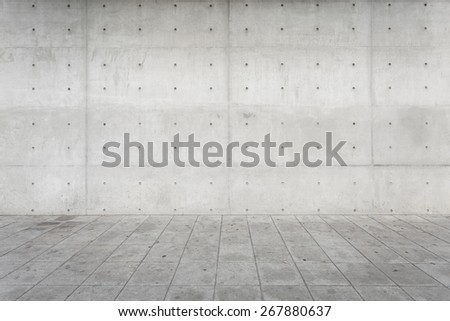 Bare Rectangle Concrete wall blocks and square cement floor textured background - stock photo