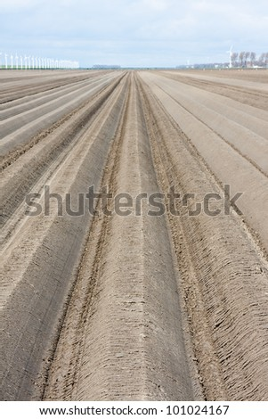 Bare winter farmland in the netherlands, waiting for spring - stock photo