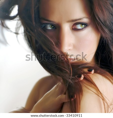Bared shoulder of the girl with chestnut hair - stock photo