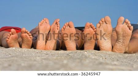 Barefoot on sand - stock photo