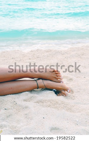 Barefoot on the sandy beach in Maldives - stock photo