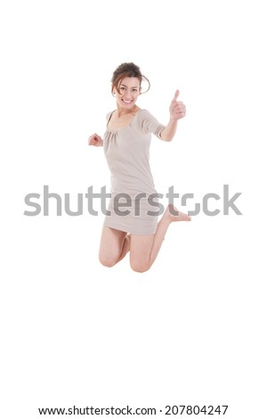Barefoot woman jumping out of joy in a dress, Successful girl having fun - stock photo