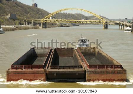 barge on the Monongahela River - stock photo