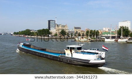 Barge ship on the river Meuse in Rotterdam. The Netherlands - stock photo