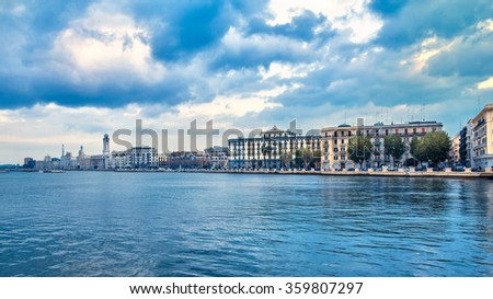 Bari seafront city view from marina. Blue sea and cloudy sky. Filtered image - stock photo