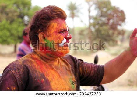 Barisadri, INDIA - MAR 27: Unidentified Young Boy during Holi, Festival of Colors, March 27, 2013 in Barisadri, Rajasthan, India. the biggest religious festivals of India & Asia. - stock photo