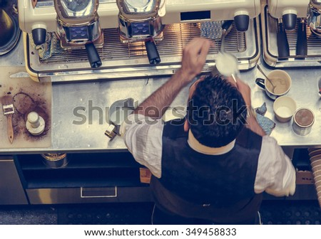Barista and coffee machines, vintage filter applied - stock photo