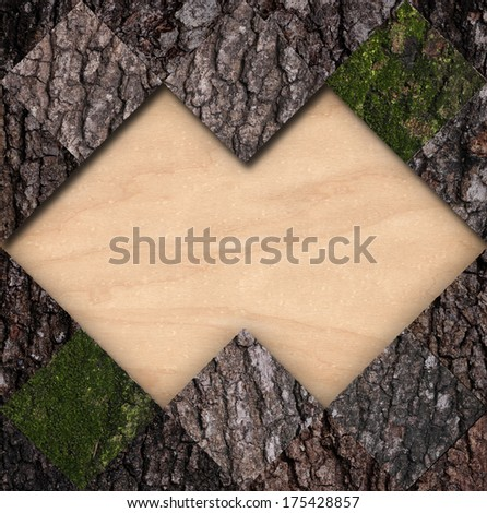 Bark with a moss tile and bare wood frame - stock photo