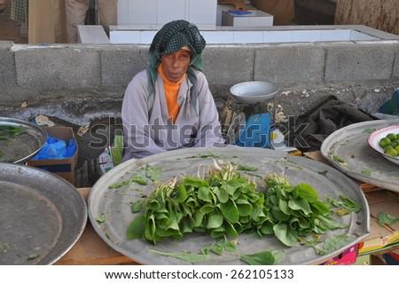 Barka, Oman - January, 03, 2014:  arab man at Daily Fish market in Barka, Oman,  - stock photo