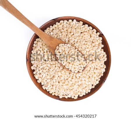 Barley rice in wood spoon on plate isolated on white background - stock photo