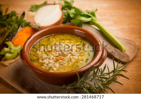 barley soup with vegetables, selective focus - stock photo