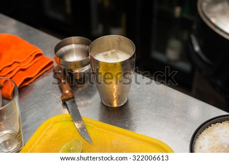 Barman at work, preparing cocktails. concept about service and beverages. - stock photo