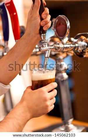 Barman brewing a beer - stock photo