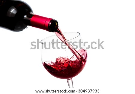 barman pouring red wine in the glass on white background - stock photo