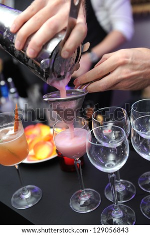 barman prepare coctail drink - stock photo