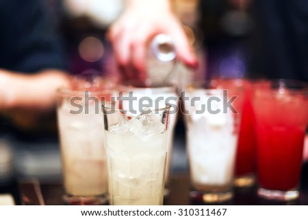 Barman stir alcohol. process of preparing a cocktail - stock photo