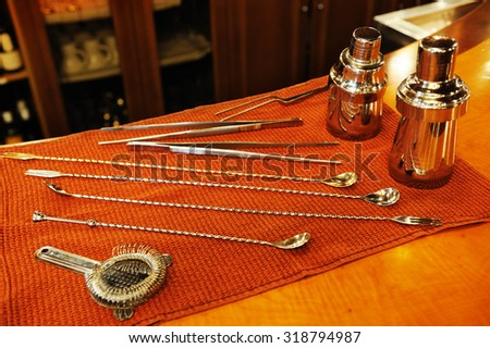 barman tools in a bar focus on the beaters - stock photo