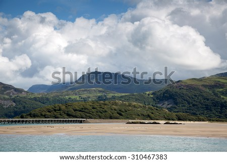 Barmouth Bridge, the Mawddach estuary with Cader Idris - stock photo