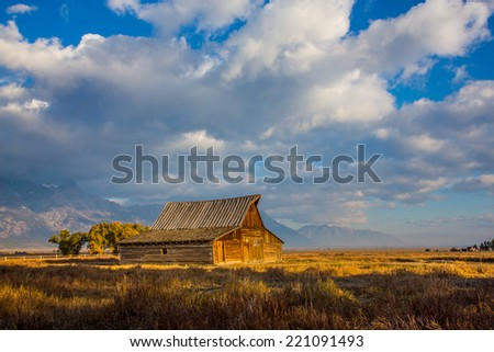 Barn at Mormon Row in Grand Teton National Park with dramatic sky. - stock photo