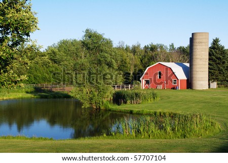 Barn by Pond - stock photo