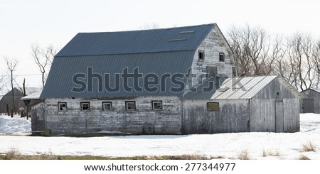 Barn in snow covered field, Hecla Grindstone Provincial Park, Manitoba, Canada - stock photo