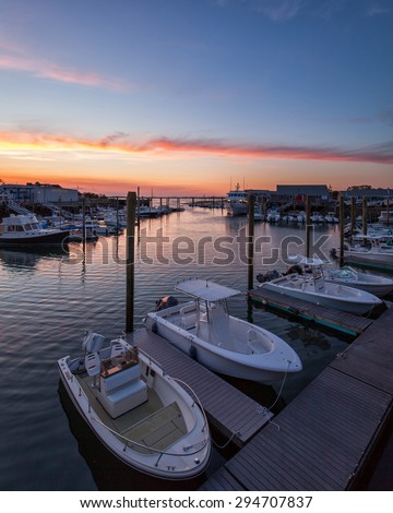 Barnstable Harbor Marina Area at Sunset showing fishing and whale watch boats. - stock photo