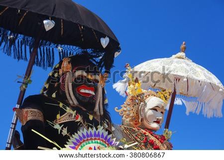 Barong Landung traditional protective spirit of Bali in human body at ceremony Melasti before Balinese New Year and silence day Nyepi. Holidays, festivals, rituals, art, culture of Indonesian people. - stock photo