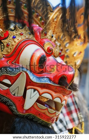 Barong - protective spirit and Bali island symbol, is featured in tourist attraction - traditional Balinese dance. Arts, religion and culture festivals of Indonesian people. Asian travel backgrounds. - stock photo