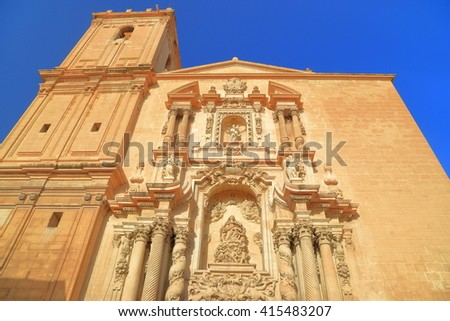 Baroque decorations of the sunny facade of Santa Maria Basilica in Elche, Alicante, Spain - stock photo