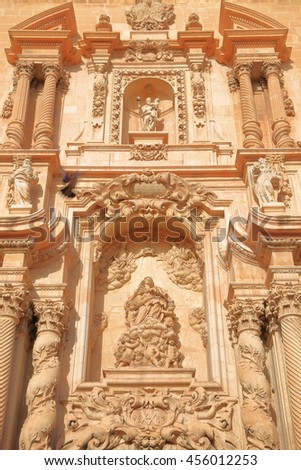 Baroque decorations on the facade of Santa Maria Basilica in Elche, Alicante, Spain - stock photo