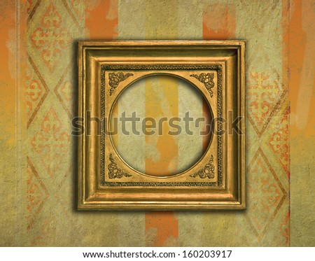 Baroque golden frame with rounded inner corners on a grunge victorian wallpaper - stock photo