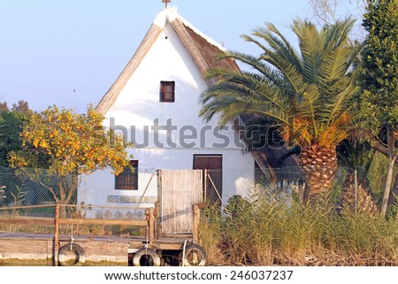 Barraca Small farmhouse typical of Valencia,La Albufera nature reserve, El Palmar, Valencia, Comunidad Valenciana, Spain.  - stock photo