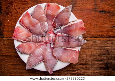 Barramundi, Silver Perch, White Perch, Sea Bass. Fresh Ocean Fish Sliced. Cooking Idea. / on Wood Table Background, Rustic Still Life Style. Top View. - stock photo