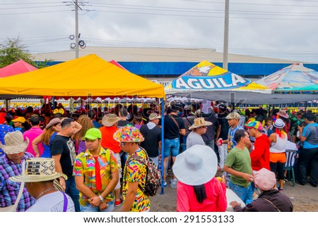 BARRANQUILLA, COLOMBIA - FEBRUARY 18, 2015: Multiple spectators watching the Carnival parade colorful vendors in Colombia's most important folklore celebration Barranquilla - stock photo