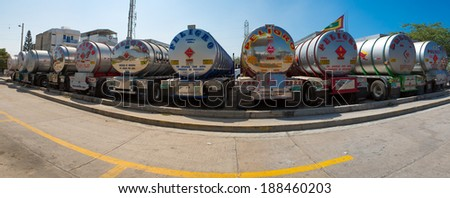 BARRANQUILLA, COLOMBIA, JANUARY 23 2014: Group of big fuel gas tanker trucks parked on highway with blue sky in Colombia in 2014. - stock photo