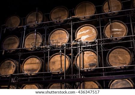 barrel brandy, wooden barrel alcohol, barrels liquor - stock photo