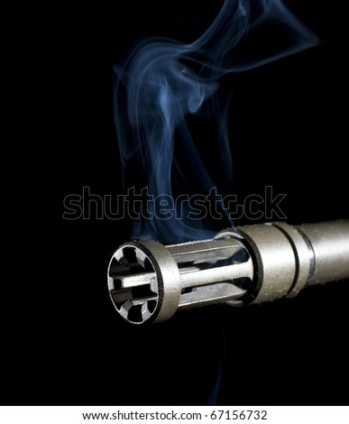 barrel of an assault rifle that is pouring out smoke - stock photo