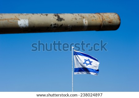 Barrel of an old centurion tank and the Israelien flag on 'tel e-saki 'on the Golan Heights in Israel - stock photo