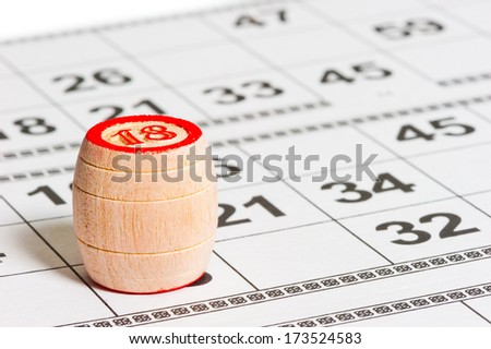 barrel with the number 18 on the playing cards - stock photo