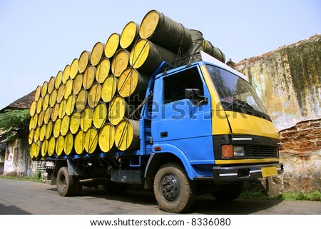 barrels stacked atop truck, south india - stock photo