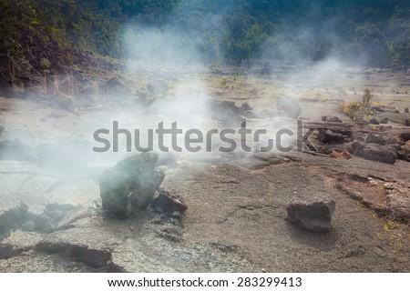 Barren bottom of Kilauea Crater with sulfur gas vents in Hawaii Volcanoes National Park, Big Island, Hawaii - stock photo