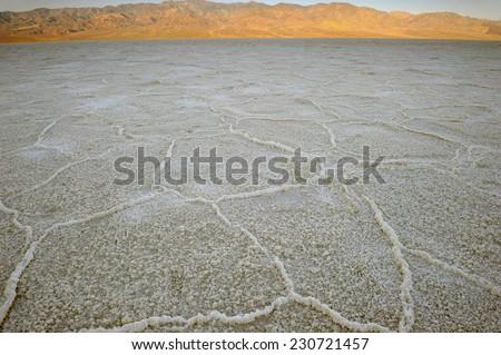 barren wastelands of the Badlands salt pan at sunrise, Death Valley national park, Mojave desert, California - stock photo