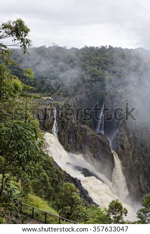 Barron Falls is a tiered cascade  waterfall on the Barron River near Cairns Queensland Australia - stock photo