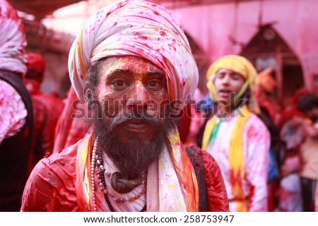 BARSANA - FEB 27: An unidentified devotees celebrate the festival Holi  at Radharani temple on February 27, 2015 in Barsana, India. Holi is the most celebrated and colorful festival in India - stock photo