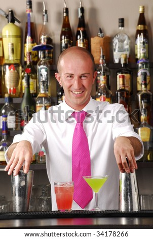 Bartender and cocktails. barkeeper and colored cocktails - stock photo