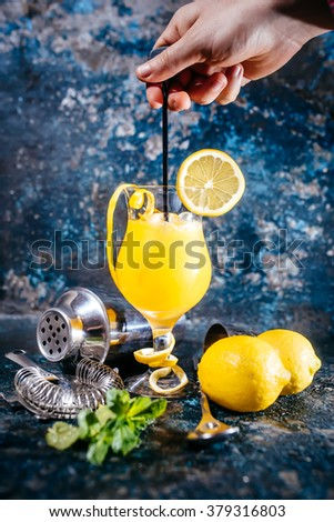 bartender preparing vodka alcoholic cocktail with ice and mint. Cocktail drinks served at restaurant, pub or bar - stock photo