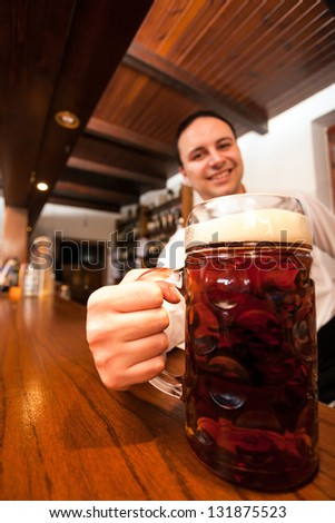 Bartender serving a giant beer - stock photo