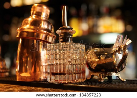 Bartender tools on bar counter, warm light, retro style photo - stock photo