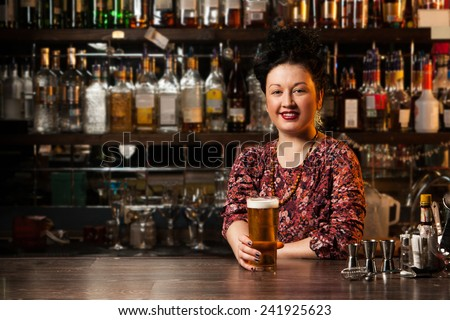 Bartender with beer - stock photo