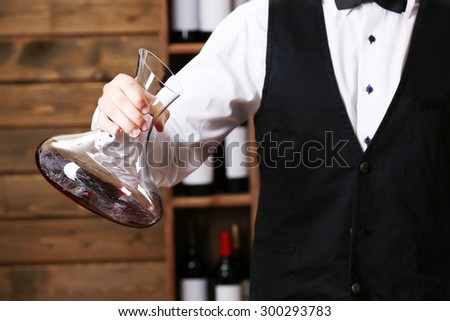 Bartender working on bar background - stock photo